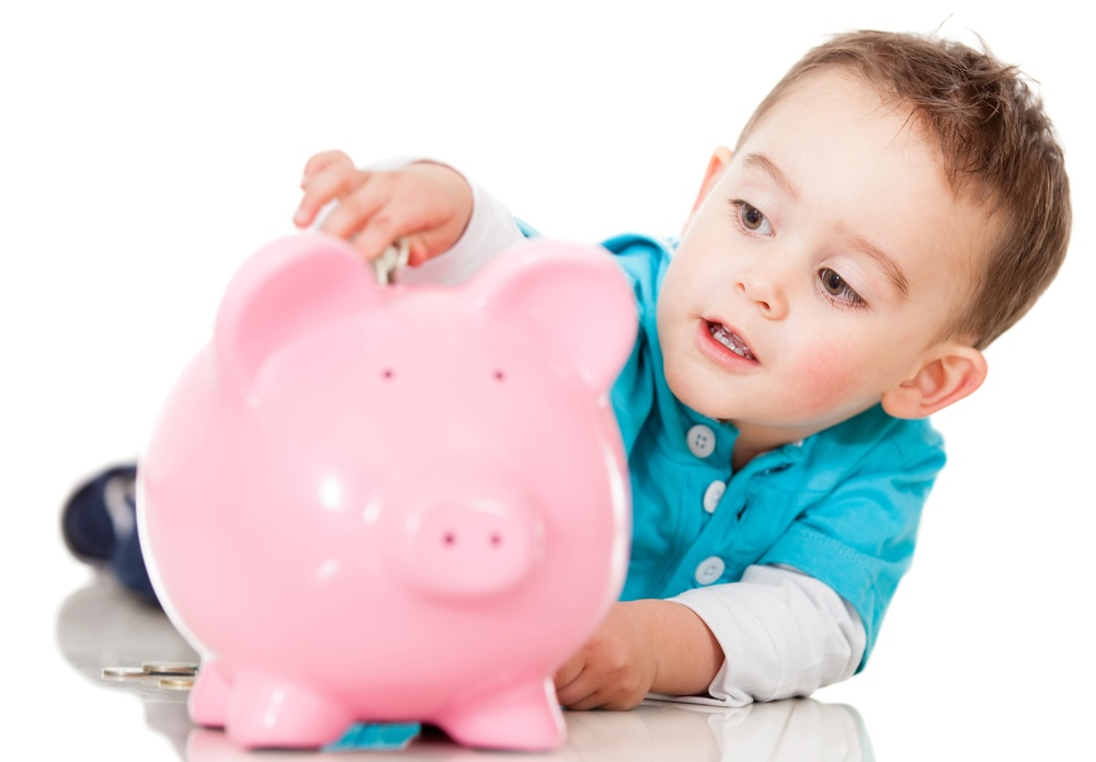 Boy saving money in a piggybank - isolated over a white background-2